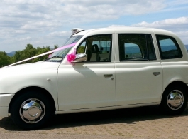 Classic White London Taxi for weddings in Bristol